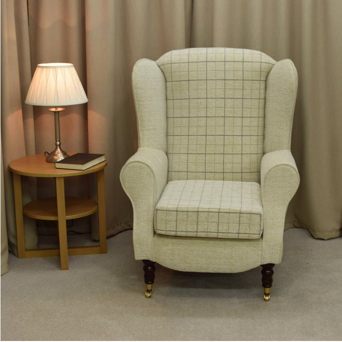 Duchess Wingback Armchair in a Maida Vale check and plain Fabric with front castor Legs